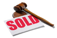 gavel resting with red sold sign